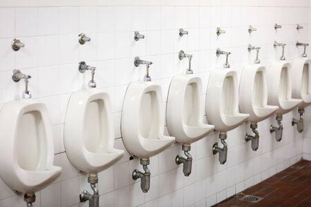 public restroom: A row of urinals in a public restroom.