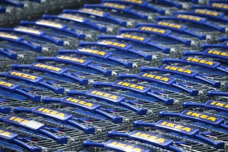 retailer: ZAGREB, CROATIA - FEBRUARY 23 : A large group of IKEA shopping carts lined up in rows in trolleys area of IKEA Zagreb store on February 23rd, 2015 in Zagreb, Croatia. Founded in Sweden in 1943, Ikea is the worlds largest furniture retailer.