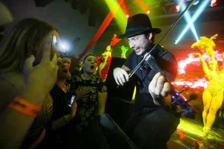 fiesta popular: ZAGREB, CROATIA - APRIL 9, 2016 : The famous violinist Miguel Lara performing to the crowd on La Fiesta Stage by Sensation party in Hypo center in Zagreb, Croatia.