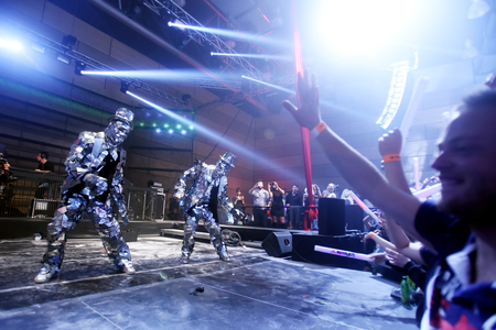 sensation: ZAGREB, CROATIA - APRIL 9, 2016 : Two performers dressed in a robot suit dancing on the stage on La Fiesta Stage by Sensation party in Hypo center in Zagreb, Croatia. Editorial