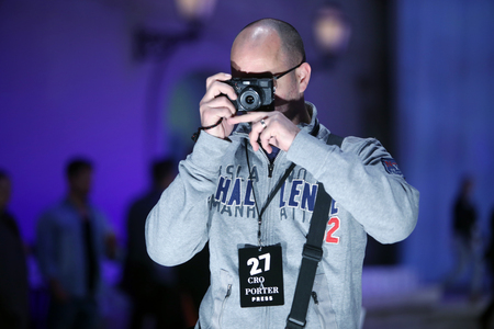 ZAGREB, CROATIA - APRIL 20, 2016 : Photographer is photographing a models that are wearing clothes designed by Boudoir on the Cro a Porter fashion show at Klovicevi Dvori in Zagreb, Croatia.