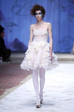 boudoir: ZAGREB, CROATIA - APRIL 20, 2016 : Fashion model wearing clothes designed by Boudoir on the Cro a Porter fashion show at Klovicevi Dvori in Zagreb, Croatia. Batiste presents Boudoir 15th birthday.