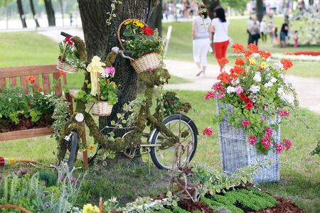 sightsee: ZAGREB, CROATIA - JUNE 3, 2016 : A flower installation with an old bicycle and flowers exhibited at Floraart at Bundek park in Zagreb, Croatia.
