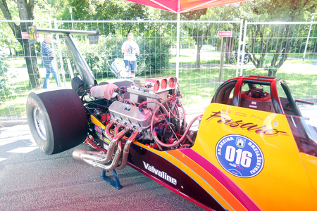 dragster: ZAGREB, CROATIA - JUNE 4, 2016 : Engine of parked dragster that is main attraction at Fast and furious street race at Avenue Dubrovnik in Zagreb, Croatia. Editorial