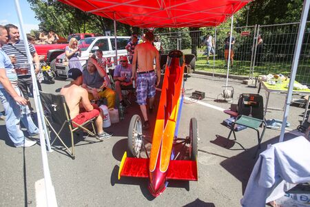 dragster: ZAGREB, CROATIA - JUNE 4, 2016 : People sightseeing parked dragster that is main attraction at Fast and furious street race at Avenue Dubrovnik in Zagreb, Croatia.