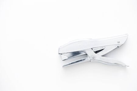 detach: A top view of a stapler on white background. Stock Photo