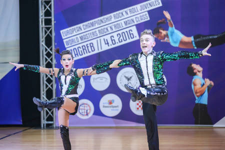 semi dress: ZAGREB, CROATIA - JUNE 4, 2016 : Semi final of European Championship Rock n roll Juveniles in Zagreb, Croatia. Performance of dancing couple from Russian Federation, Gorbunov Dmitrii and Krasova Yana.
