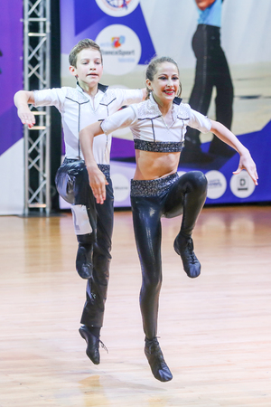 juveniles: ZAGREB, CROATIA - JUNE 4, 2016 : Finals of European Championship Rock n roll Juveniles in Zagreb, Croatia. Performance of dancing couple from Hungary, Csanki Gabor and Poncz Zsofia-Ilona.