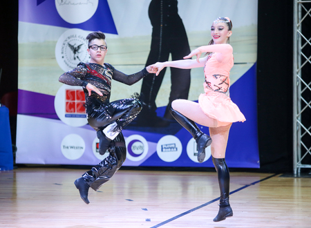 juveniles: ZAGREB, CROATIA - JUNE 4, 2016 : Semi final of European Championship Rock n roll Juveniles in Zagreb, Croatia. Performance of dancing couple from France, Delatorre Marty and Portillo Ophelie.