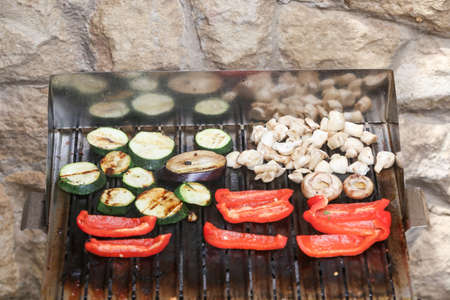 oiled: Assorted grilled vegetables on the barbecue grid. Stock Photo