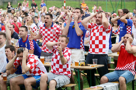 missed: ZAGREB,CROATIA - JUNE 17,2016 : Croatian football fans on the playground at Jarun,watching EURO 2016 match Czech Republic vs Croatia in Zagreb, Croatia. Fans disappointed by missed shot of Croatia team.