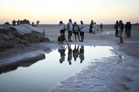 CHOTT EL JERID, TUNISIA - SEPTEMBER 17th, 2012 : Tourists at Chott El Jerid, a large salt lake in southern Tunisia. Chott El Jerid is the largest salt pan of the Sahara and it can be crossed by foot. Editorial
