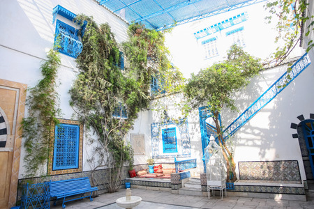 known: SIDI BOU SAID, TUNISIA - SEPTEMBER 14, 2012: The courtyard of a typical house in Sidi Bou Said,Tunisia. Sidi Bou Said is a town in northern Tunisia known for the use of blue and white in its architecture.