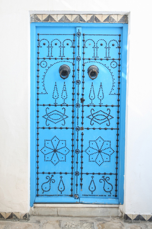 sidi bou said: SIDI BOU SAID, TUNISIA - SEPTEMBER 14, 2012 : A detail of blue gates in a typical house in Sidi Bou Said,Tunisia. Sidi Bou Said is a town in northern Tunisia known for the use of blue and white in its architecture. Stock Photo