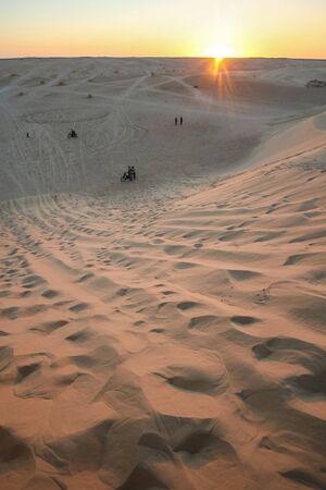 The dunes of Sahara desert at sunset in Ong Jemel,Tozeur,Tunisia. Stock Photo