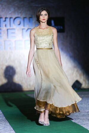 green and gold: ZAGREB,CROATIA - JUNE 3,2016 : Model wearing collection by Sylvio Roubertto Kovacic,New York powered by Romerquelle on the Fashion Week Zagreb fashion show in the Green Gold Centre in Zagreb,Croatia. Editorial