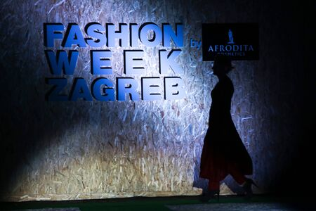 igor: ZAGREB, CROATIA - JUNE 3,2016 : Model wearing clothes designed by Igor Galas on the Fashion Week Zagreb fashion show in the park Green Gold Centre in Zagreb,Croatia. Fashion show Mamita by Igor Galas.