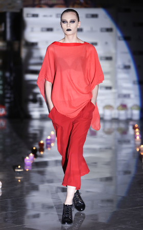simone: ZAGREB, CROATIA - JUNE 4, 2016 : Model wearing clothes designed by Simone Manojlovic on the Fashion Week Zagreb fashion show in the Green Gold Centre in Zagreb, Croatia. Editorial