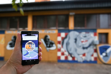 VELIKA GORICA, CROATIA- JULY 15, 2016 : A gamer using a smartphone to play Pokemon Go in Velika Gorica, Croatia. Pokemon Go is a free-to-play augmented reality mobile game developed by Nintendo.