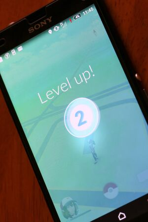 nintendo: VELIKA GORICA, CROATIA- JULY 15, 2016 : Level up on a Pokemon Go game on the smartphone. Pokemon Go is a free-to-play augmented reality mobile game developed by Nintendo. Editorial