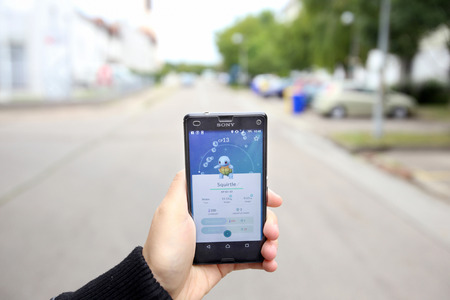VELIKA GORICA, CROATIA- JULY 15, 2016 : A gamer using a smartphone to play Pokemon Go in Velika Gorica, Croatia. Pokemon Go is a free-to-play augmented reality mobile game developed by Nintendo.
