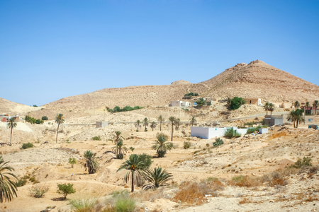 matmata: The berber village of Matmata at the beggining of the Sahara desert in south Tunisia. Matmata is famous for its troglodyte cave dwellings.