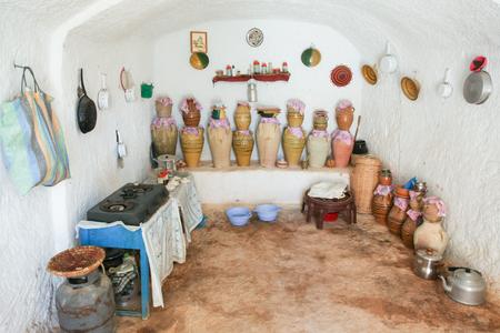 troglodyte: MATMATA, TUNISIA - SEPTEMBER 17, 2012 : The interior of kitchen in original troglodyte home in berber village in Matmata, Tunisia. Matmata is the largest region of the troglodyte communities. Editorial