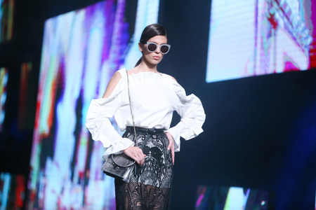 ZAGREB, CROATIA- OCTOBER 12, 2016: Fashion model wearing clothes for autumn-winter, designed by eNVy room on the Bipa Fashion.hr fashion show in Zagreb, Croatia.
