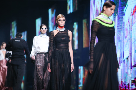 envy: ZAGREB, CROATIA- OCTOBER 12, 2016: Fashion model wearing clothes for autumn-winter, designed by eNVy room on the Bipa Fashion.hr fashion show in Zagreb, Croatia.