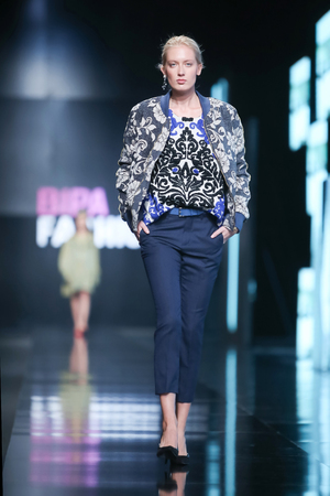 sever: ZAGREB, CROATIA- OCTOBER 11, 2016: Fashion model wearing clothes for autumn-winter, designed by Robert Sever on the Bipa Fashion.hr fashion show in Zagreb, Croatia.