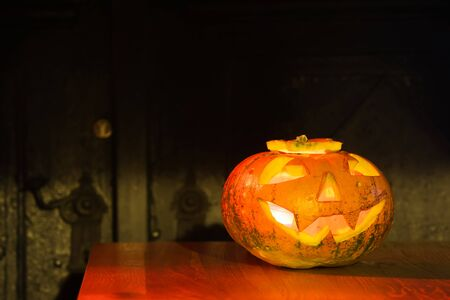 wood carvings: Halloweens pumpkins on wooden table. Stock Photo