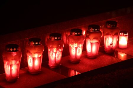 all souls' day: A group of lampions lined up on grave stone  at cemetery on All Saints day in  Croatia.