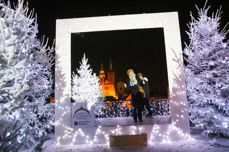 advent time: ZAGREB, CROATIA - DECEMBER 1th, 2016: Advent time in city center of Zagreb,Croatia.People in the Gradec, old town taking photos in the Advent photo frame overlooking the city and the Zagreb cathedral. Editorial