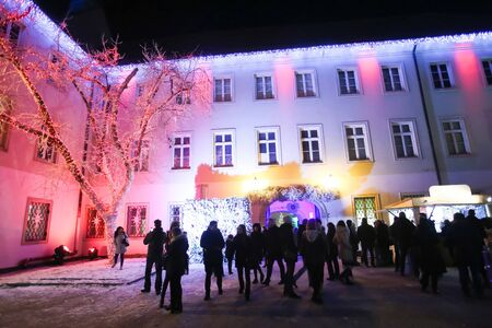 religious event: ZAGREB, CROATIA - DECEMBER 1th, 2016: Advent time in city center of Zagreb, Croatia. People sightseeing the ornate Art gallery Klovicevi Dvori in the Gradec, upper old town. Editorial