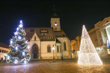 ZAGREB, CROATIA - DECEMBER 1, 2016: Advent time in city center of Zagreb,Croatia. The illuminating Christmas trees in front of the Saint Marks Church at St. Marks Square in the upper old town Gradec.