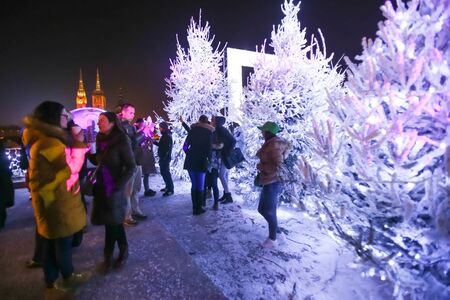 advent time: ZAGREB, CROATIA - DECEMBER 1th, 2016: Advent time in city center of Zagreb, Croatia. People gathering in the upper old town Gradec in front of the Advent photo frame overlooking the city.