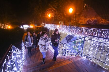 advent time: ZAGREB, CROATIA - DECEMBER 1th, 2016: Advent time in city center of Zagreb, Croatia. People climbing up the illuminated stairs leading to the Gradec, upper old town.