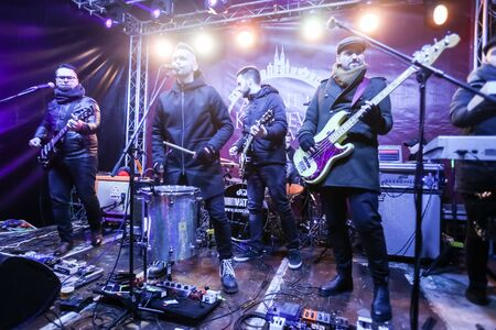 advent time: ZAGREB, CROATIA - DECEMBER 1th, 2016: Advent time in city center of Zagreb, Croatia. Famous croatian rock band Vatra performing on stage in front of Art gallery Klovicevi Dvori in the upper old town. Editorial