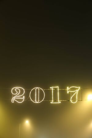 A 2017 illuminating decoration sign on a wire.