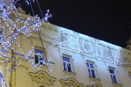 advent time: ZAGREB, CROATIA - DECEMBER 23, 2016: Advent time in city center of Zagreb, Croatia. The illuminating 2017 sign on building at night on central Jelacic Square.