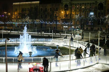 advent time: ZAGREB, CROATIA - DECEMBER 23, 2016: People skating in the city ice skating rink at Advent time in King Tomislav Park in Zagreb, Croatia.
