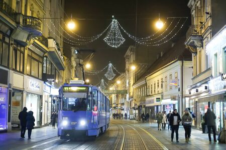 advent time: ZAGREB, CROATIA - DECEMBER 23rd, 2016: People walking down the Ilica street decorated with Christmas decoration at Advent time in Zagreb, Croatia. Editorial
