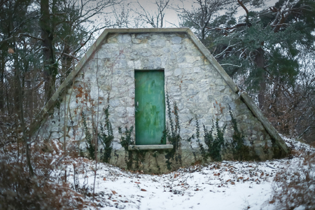 A shed in the snowy forest. Stock Photo