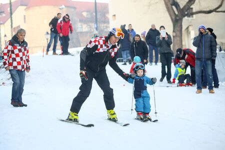 ZAGREB, CROATIA - JANUARY 15, 2017 : FIS World Snow Day for kids with free skiing and snowboarding lessons on the ski slope in Bakaceva street, on the road from the cathedral to the main square. Ivica Kostelic with his son Ivan on the slope.