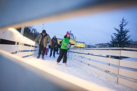 ZAGREB, CROATIA - JANUARY 15, 2017 : A view through the fence of people skating in the city ice skating rink in King Tomislav Square in Zagreb, Croatia. Editorial