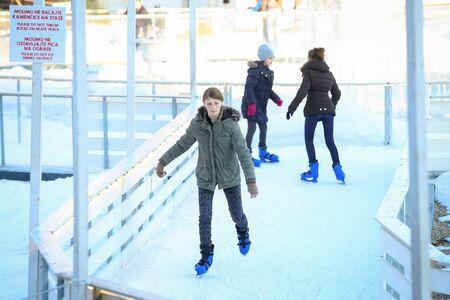 ZAGREB, CROATIA - JANUARY 15, 2017 : People skating in the city ice skating rink in King Tomislav Square in Zagreb, Croatia.