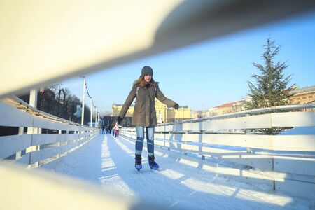 ZAGREB, CROATIA - JANUARY 15, 2017 : A view through the fence of a woman skating in the city ice skating rink in King Tomislav Square in Zagreb, Croatia. Editorial