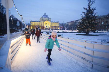 ZAGREB, CROATIA - JANUARY 15, 2017 : Children skating in the city ice skating rink in King Tomislav Square in Zagreb, Croatia.