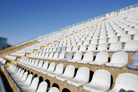 ZAGREB, CROATIA - FEBRUARY 14 : Old white chairs on empty eastern grandstand of the football stadium Maksimir on February 14, 2007 in Zagreb, Croatia.
