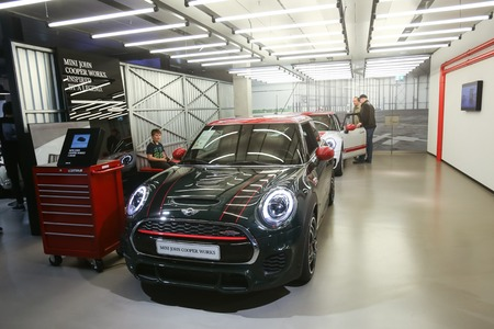 cooper: MUNICH, GERMANY - MAY 6, 2017 : People sightseeing the exhibited Mini John Cooper automobile in the BMW Welt exhibition center in Munich, Germany.